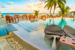 Table and chairs at restaurant in tropical Maldives island . Stock Photography