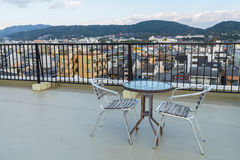 Table and chairs on  roof top terrace exterior . Royalty Free Stock Photo