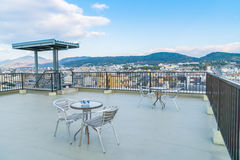 Table and chairs on  roof top terrace exterior . Royalty Free Stock Images