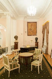 Table, chairs, sculptures and paintings in foyer of Moscow Conse Royalty Free Stock Photography