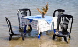 Table and chairs in the sea Royalty Free Stock Image