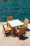 Table and Chairs by the Sea Stock Photography