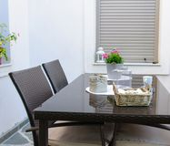 Table and chairs set for breakfast on a terrace Stock Photo