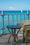 Table and chairs set for ocean view Royalty Free Stock Photo