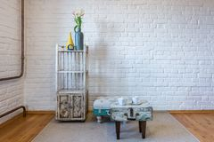Table, chairs, shelves on the background of a white brick wall in vintage loft interior.  royalty free stock photo