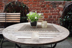 Table and chairs of small cafe. Stock Photo
