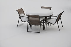 Table and chairs in the snow Royalty Free Stock Images