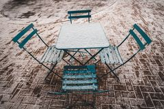 Table and chairs in snow stock image
