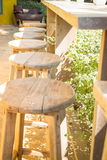 Table and chairs standing in the garden with shadows Stock Photo