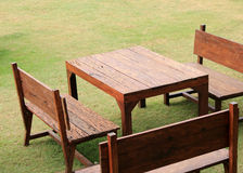Table and chairs standing on a lawn Stock Image