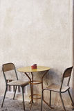 A Table And Chairs On the stereet Royalty Free Stock Photos
