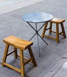 Table and Chairs on Street Stock Photos