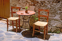 Table and chairs on the street, Gre. Table and chairs on the street in Chania city, Greece stock image