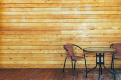 Table And Chairs On Summer Wooden Terrace. Vacation Holiday Relaxation Concept. Table And Two Chairs On Summer Wooden Terrace, Front View. Vacation Holiday Royalty Free Stock Photography