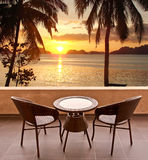 Table and chairs on a terrace, view on a tropical beach Royalty Free Stock Photos