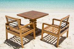 Table with chairs at the tropical beach at Maldives. Table with chairs at the tropical beach Royalty Free Stock Image