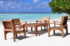 Table and chairs at tropical beach restaurant, Maldives Stock Image