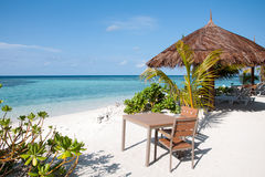 Table and chairs at tropical beach restaurant, Maldives Stock Photography