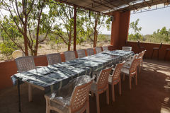 Table and chairs on veranda. Turmi. Ethiopia. Africa. Long table and chairs on veranda. Turmi. Ethiopia. Africa Royalty Free Stock Photography