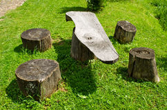 Table and chairs of wood trunk stumps. Rest place Stock Photography