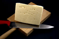 Table cheese. Displays a cutting board with a piece of typical Spanish cheese Stock Photography