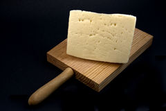 Table cheese. Displays a cutting board with a piece of typical Spanish cheese Stock Image