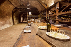 Table with cheese and wine glasses winside the tasting room of old cellar Khareba Winery Stock Photos