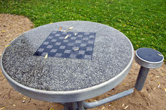 Table with chess board and chairs in the park Stock Images