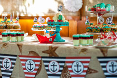 Table on the children's holiday decoration  table decoration in marine style. Table decoration in marine style   nautical theme Stock Photo