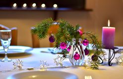 Table with christmas decoration in purple colors. Celebration. A colorful laid table decorated different in purple with xmas decoration for a christmas dinner stock images