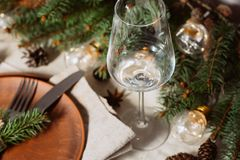 Table with Christmas decorations and garland, ware, green spruce branches. Winter flat lay royalty free stock photo