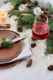 Table with Christmas decorations and garland, ware, green spruce branches. Winter flat lay stock photos