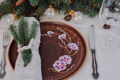Table with Christmas decorations and garland, ware, green spruce branches. Winter flat lay royalty free stock photography