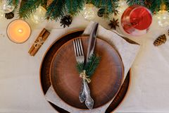 Table with Christmas decorations and garland, ware, green spruce branches. Winter flat lay royalty free stock photos