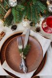 Table with Christmas decorations and garland, ware, green spruce branches. Winter flat lay stock photo
