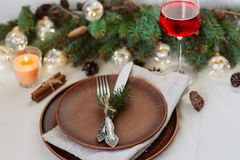 Table with Christmas decorations and garland, ware, green spruce branches. Winter flat lay royalty free stock images