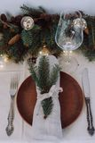 Table with Christmas decorations and garland, ware, green spruce branches. Winter flat lay royalty free stock image