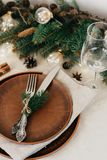 Table with Christmas decorations and garland, ware, green spruce branches. Winter flat lay stock image