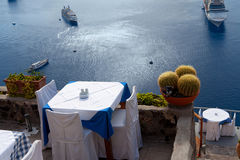 Table on the cliff above the sea Stock Images