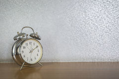 Table clock  in the bedroom Royalty Free Stock Photography