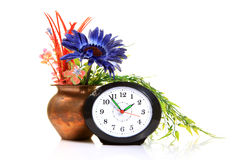 Table clock and flowers Royalty Free Stock Photography