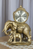 Table clock. The clock in the form of a statue of gold with elephants Stock Images