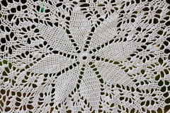 Table cloth. Beautiful  white crochet tablecloth for background Stock Image