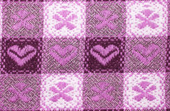 Table cloth. Pink and white table cloth close up with flowers and hearts, for background use Stock Images