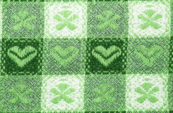 Table cloth. Green and white table cloth close up with flowers and hearts, for background use Royalty Free Stock Images