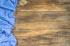 Table cloth blue checkered on rustic wooden table. Brown wooden table with tablecloth blue checkered and copy space Stock Photo