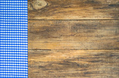 Table cloth blue checkered on wooden board. Royalty Free Stock Photos