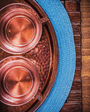 Table cloth coppery tray tea cups food and drink Stock Photos