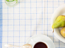 Table cloth with a cup of tea Royalty Free Stock Photography