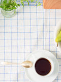Table cloth with a cup of tea Royalty Free Stock Images
